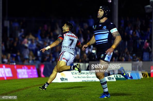 Shaun Johnson of the Warriors celebrates his match winning try during the round nine NRL match between the Sharks and the Warriors at Remondis...