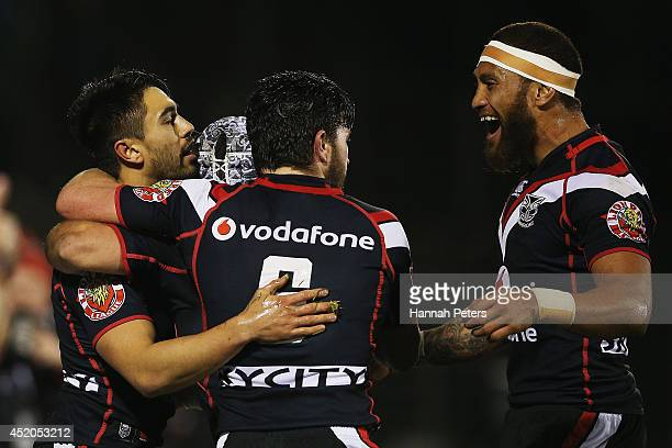 Shaun Johnson of the Warriors celebrates with Chad Townsend and Manu Vatuvei after scoring a try during the round 18 NRL match between the New...