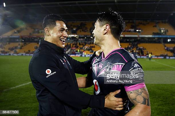 Shaun Johnson of the Warriors celebrates with teammate Roger TuivasaSheck after winning the round 21 NRL match between the New Zealand Warriors and...