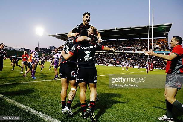 Shaun Johnson of the Warriors celebrates with the team after Tuimoala Lolohea's try during the round 18 NRL match between the New Zealand Warriors...