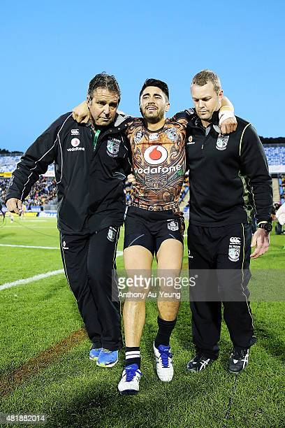 Shaun Johnson of the Warriors is carried off the field after suffering an ankle injury during the round 20 NRL match between the New Zealand Warriors...