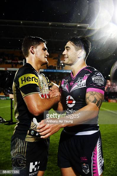 Shaun Johnson of the Warriors is congratulated by Nathan Cleary of the Panthers after the round 21 NRL match between the New Zealand Warriors and the...