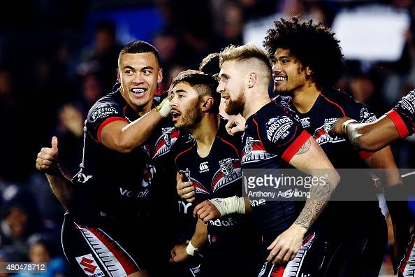 Shaun Johnson of the Warriors is mobbed by teammates after scoring a solo try during the round 18 NRL match between the New Zealand Warriors and the...