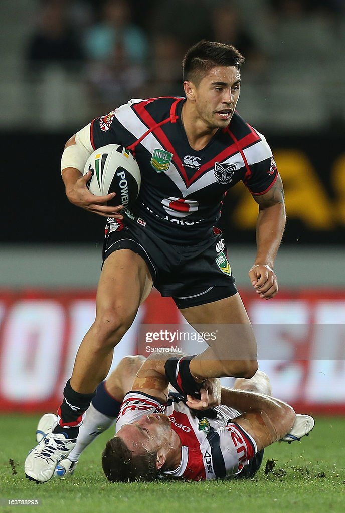 Shaun Johnson of the Warriors is tackled by James Maloney of the Roosters during the round two NRL match between the New Zealand Warriors and the Sydney Roosters at Eden Park on March 16, 2013 in Auckland, New Zealand.