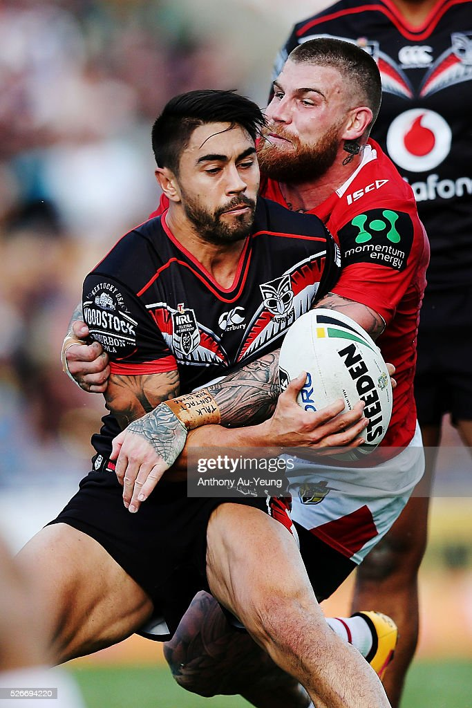 Shaun Johnson of the Warriors is tackled by <a gi-track='captionPersonalityLinkClicked' href=/galleries/search?phrase=Josh+Dugan&family=editorial&specificpeople=5553377 ng-click='$event.stopPropagation()'>Josh Dugan</a> of the Dragons during the round nine NRL match between the New Zealand Warriors and the St George Illawarra Dragons at Mt Smart Stadium on May 1, 2016 in Auckland, New Zealand.