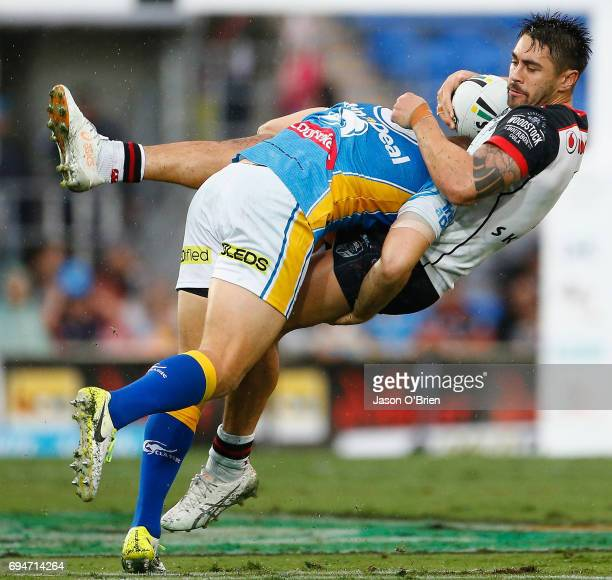 Shaun Johnson of the Warriors is tackled during the round 14 NRL match between the Gold Coast Titans and the New Zealand Warriors at Cbus Super...