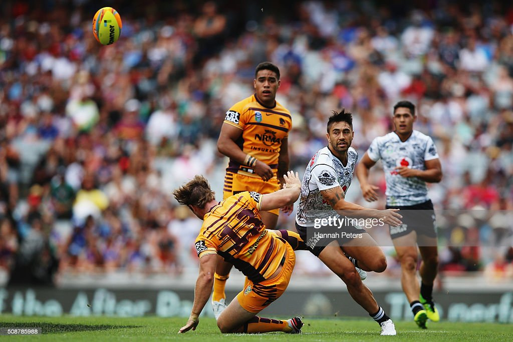 Shaun Johnson of the Warriors kicks the ball through during the 2016 Auckland Nines match between the New Zealand Warriors and the Brisbane Broncos at Eden Park on February 7, 2016 in Auckland, New Zealand.