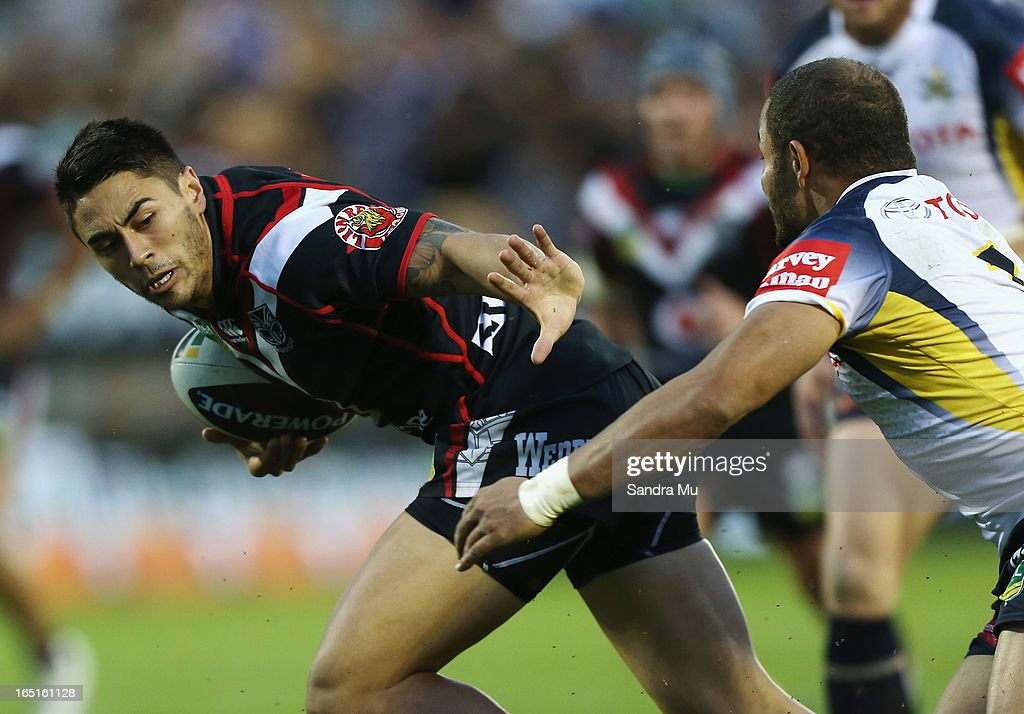 Shaun Johnson of the Warriors looks to fend during the round four NRL match between the New Zealand Warriors and the North Queensland Cowboys at Mt Smart Stadium on April 1, 2013 in Auckland, New Zealand.