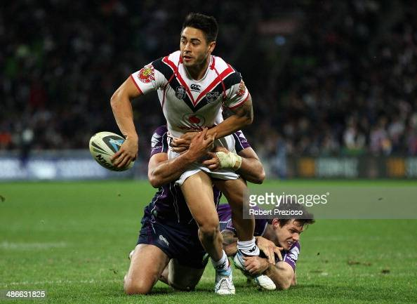 Shaun Johnson of the Warriors looks to offload the ball during the round 8 NRL match between the Melbourne Storm and the New Zealand Warriors at AAMI...