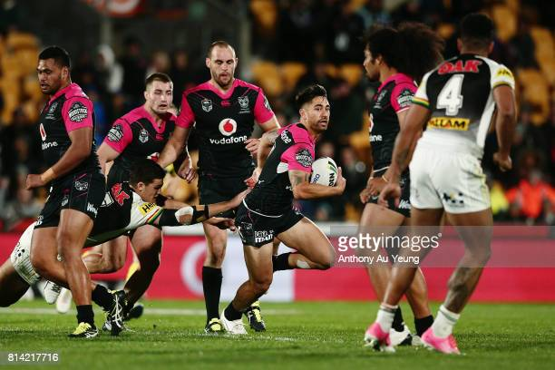 Shaun Johnson of the Warriors makes a break against Nathan Cleary of the Panthers during the round 19 NRL match between the New Zealand Warriors and...