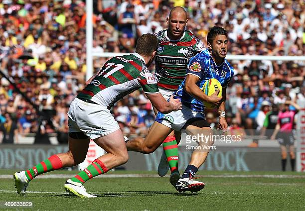 Shaun Johnson of the Warriors makes a break during the match between the Warriors and the Rabbitohs in the Auckland NRL Nines at Eden Park on...