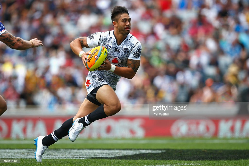 Shaun Johnson of the Warriors makes a break during the match between the New Zealand Warriors and the Bulldogs during the 2016 NRL Auckland Nines at Eden Park on February 6, 2016 in Auckland, New Zealand.