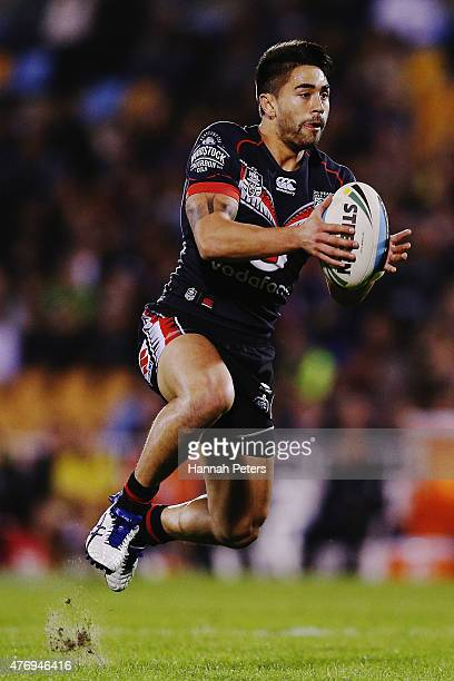 Shaun Johnson of the Warriors makes a break during the round 14 NRL match between the New Zealand Warriors and the Sydney Roosters at Mt Smart...