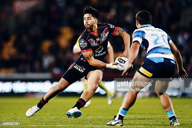 Shaun Johnson of the Warriors makes a run against Cameron Cullen of the Titans during the round 17 NRL match between the New Zealand Warriors and the...