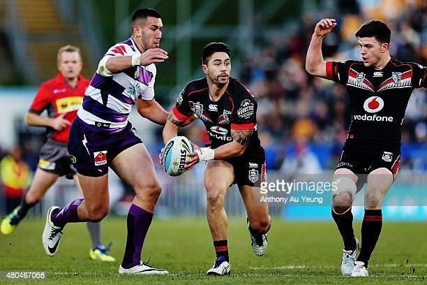 Shaun Johnson of the Warriors makes a run against Nelson AsofaSolomona of the Storm during the round 18 NRL match between the New Zealand Warriors...