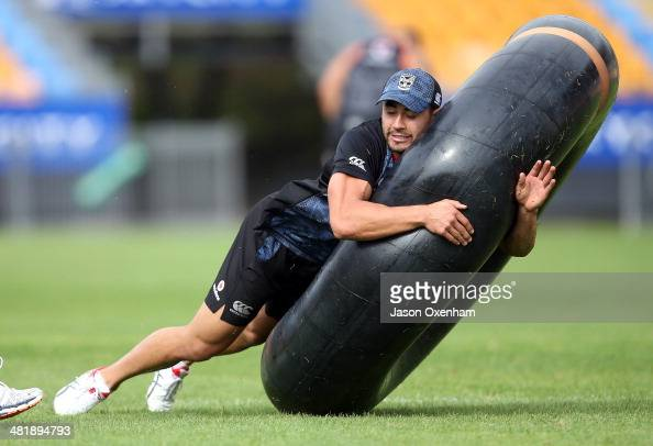 Shaun Johnson of the Warriors practices tackling on a large inner tube during a New Zealand Warriors NRL training session at Mt Smart Stadium on...