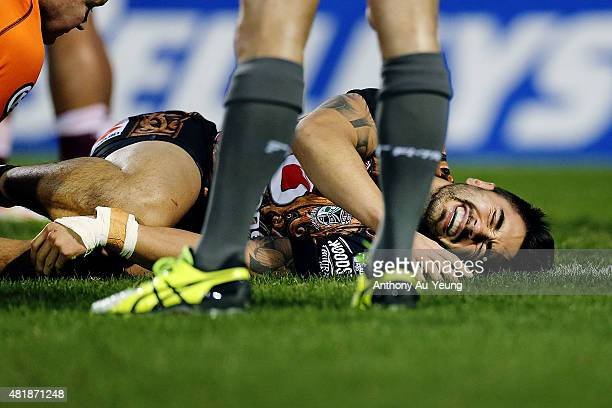 Shaun Johnson of the Warriors reacts after suffering an injury to his leg during the round 20 NRL match between the New Zealand Warriors and the...