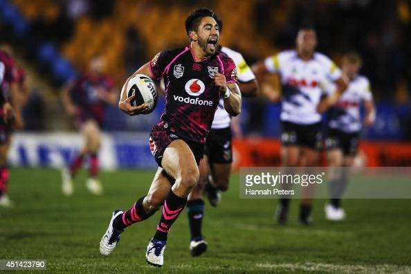 Shaun Johnson of the Warriors runs away to score a try during the round 16 NRL match between the New Zealand Warriors and the Penrith Panthers at Mt...