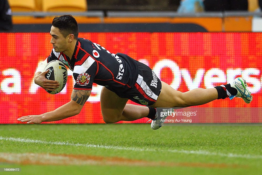 Shaun Johnson of the Warriors scores a try during the round eight NRL match between the New Zealand Warriors and the Gold Coast Titans at Mt Smart Stadium on May 5, 2013 in Auckland, New Zealand.