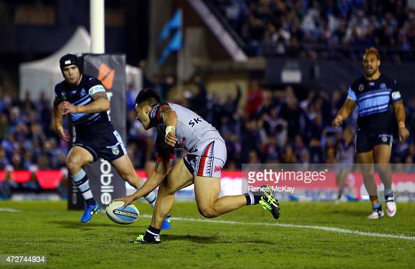 Shaun Johnson of the Warriors scores the winning try during the round nine NRL match between the Sharks and the Warriors at Remondis Stadium on May 9...