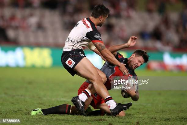 Shaun Johnson of the Warriors tackles Gareth Widdop of the Dragons during the round four NRL match between the St George Illawarra Dragons and the...