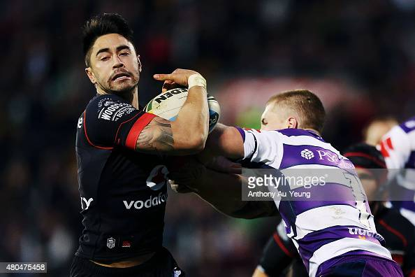Shaun Johnson of the Warriors tries to fend off Cameron Munster of the Storm during the round 18 NRL match between the New Zealand Warriors and the...