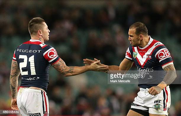 Shaun KennyDowall and Blake Ferguson of the Roosters celebrate victory in the round 26 NRL match between the Sydney Roosters and the South Sydney...