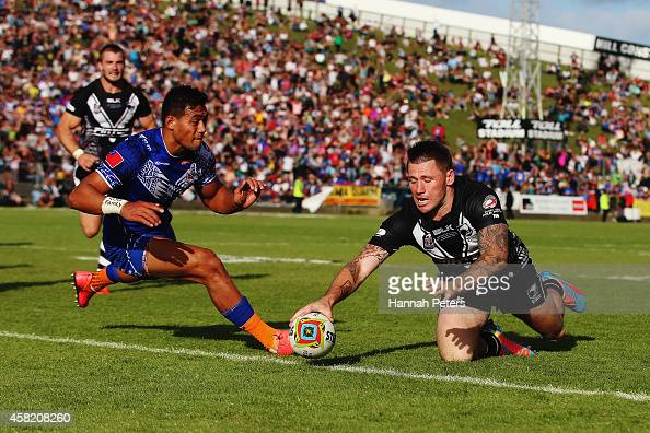 Shaun KennyDowall of New Zealand dives over to score a try during the Four Nations match between the New Zealand Kiwis and Samoa at Toll Stadium on...