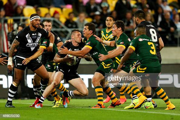 Shaun KennyDowall of New Zealand is tackled by Greg Bird of Australia during the Four Nations Final between the New Zealand Kiwis and the Australian...