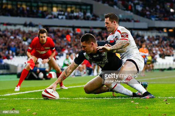 Shaun KennyDowall of New Zealand touches down a try avoiding a tackle from Zak Hardaker of England during the International Rugby League Test Series...
