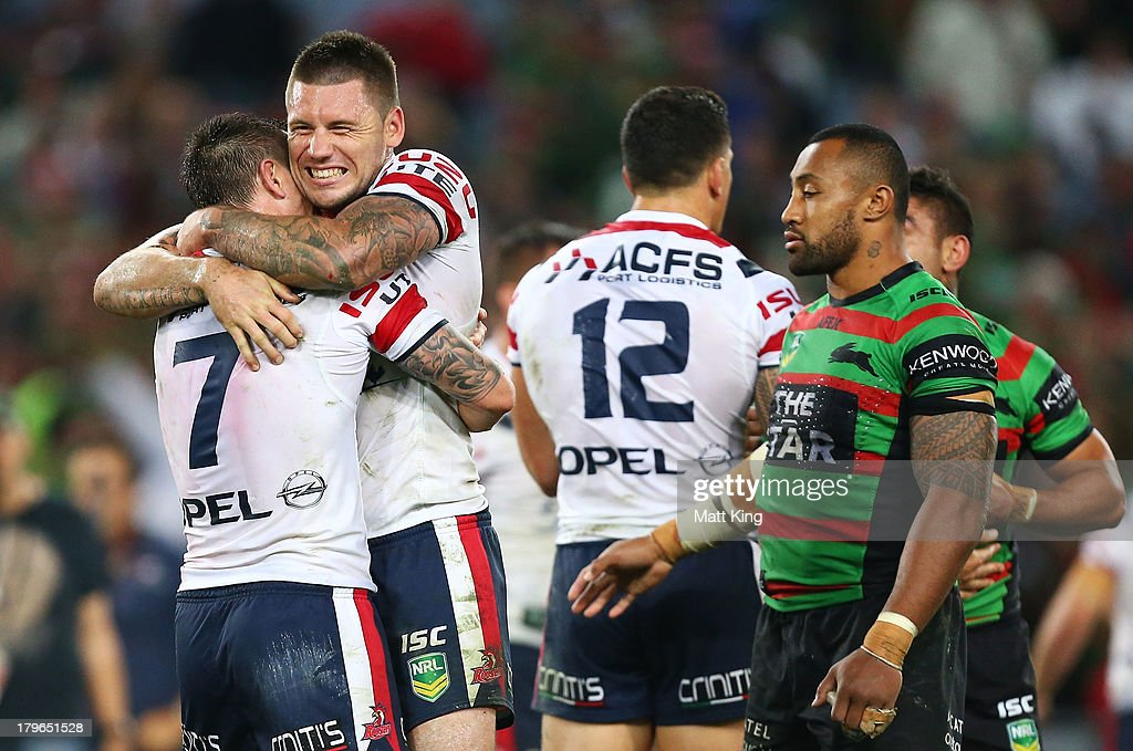 <a gi-track='captionPersonalityLinkClicked' href=/galleries/search?phrase=Shaun+Kenny-Dowall&family=editorial&specificpeople=2348788 ng-click='$event.stopPropagation()'>Shaun Kenny-Dowall</a> (R) of the Roosters celebrates with <a gi-track='captionPersonalityLinkClicked' href=/galleries/search?phrase=Mitchell+Pearce&family=editorial&specificpeople=4208962 ng-click='$event.stopPropagation()'>Mitchell Pearce</a> (L) after the fulltime during the round 26 NRL match between the South Sydney Rabbitohs and the Sydney Roosters at ANZ Stadium on September 6, 2013 in Sydney, Australia.