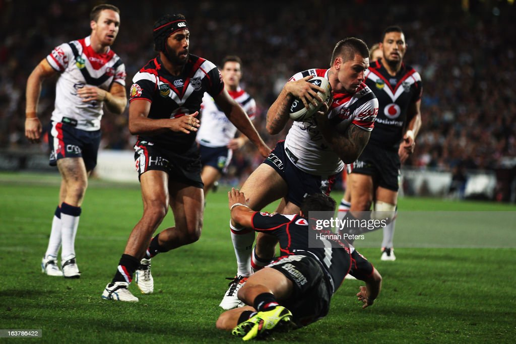 Shaun Kenny-Dowall of the Roosters dives over to score a try during the round two NRL match between the New Zealand Warriors and the Sydney Roosters at Eden Park on March 16, 2013 in Auckland, New Zealand.
