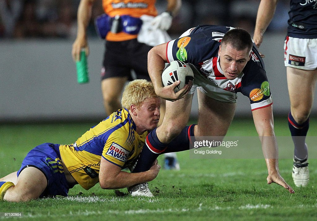 Shaun Kenny-Dowall of the Roosters is tackled during the NRL trial match between the Sydney Roosters and the Parramatta Eels at Bluetongue Stadium on February 27, 2010 in Gosford, Australia.