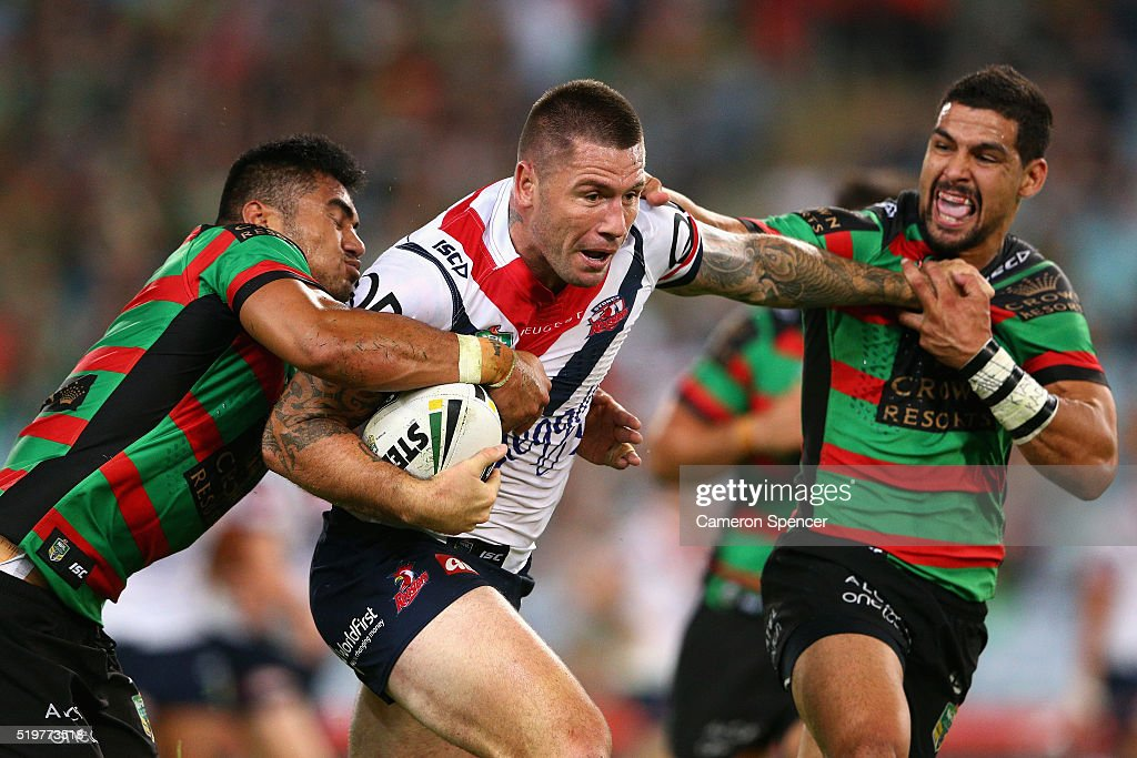 Shaun Kenny-Dowall of the Roosters is tackled during the round six NRL match between the South Sydney Rabbitohs and the Sydney Roosters at ANZ Stadium on April 8, 2016 in Sydney, Australia.