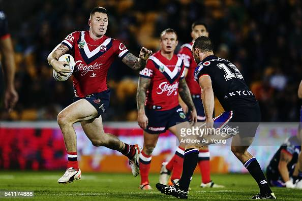 Shaun KennyDowall of the Roosters makes a run at Simon Mannering of the Warriors during the round 15 NRL match between the New Zealand Warriors and...