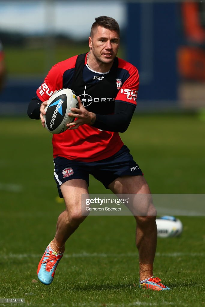 <a gi-track='captionPersonalityLinkClicked' href=/galleries/search?phrase=Shaun+Kenny-Dowall&family=editorial&specificpeople=2348788 ng-click='$event.stopPropagation()'>Shaun Kenny-Dowall</a> of the Roosters runs the ball during a Sydney Roosters NRL training session at Kippax Lake on September 3, 2014 in Sydney, Australia.