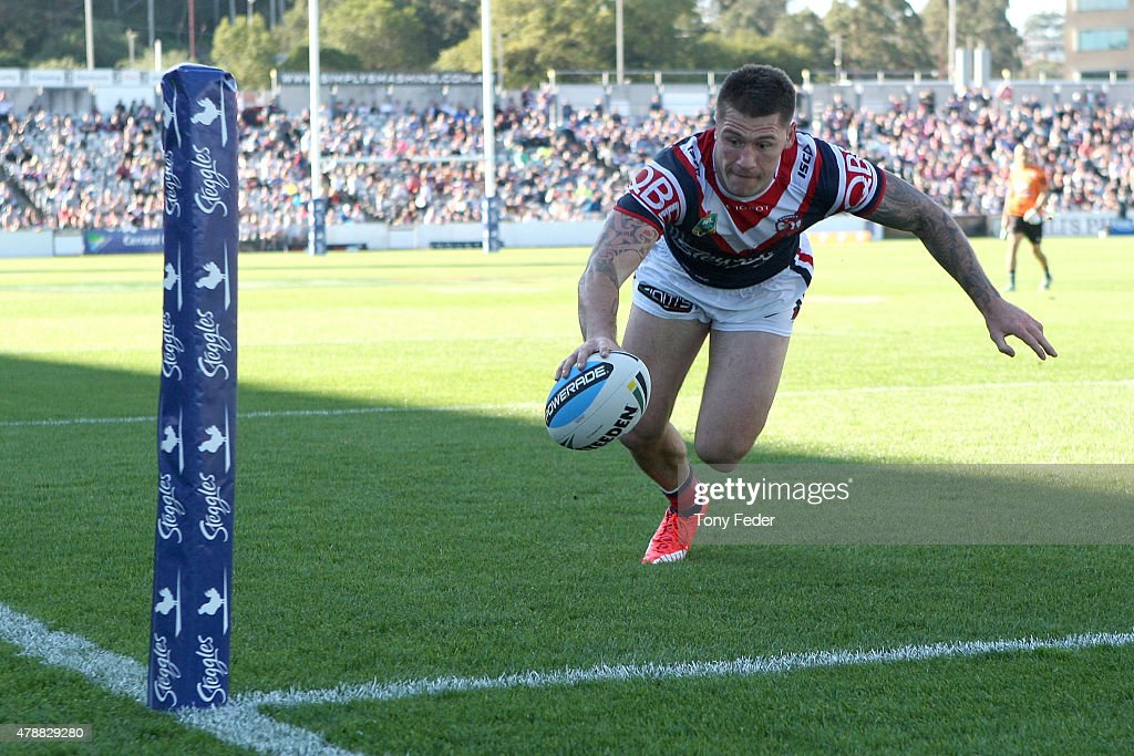 Shaun Kenny-Dowall of the Roosters scores a try during the round 16 NRL match between the Sydney Roosters and the Gold Coast Titans at Central Coast Stadium on June 28, 2015 in Gosford, Australia.