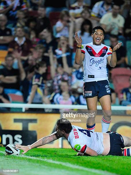 Shaun KennyDowall of the Roosters scores a try while Joseph Leilua celebrates during the round 26 NRL match between the North Queensland Cowboys and...