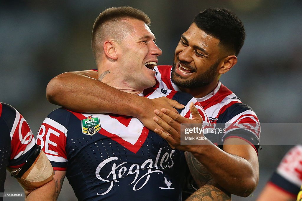 Shaun Kenny-Dowall of the Roosters shares a laugh with his team mate Daniel Tupou of the Roosters as they wait for the video referee decision during the round 10 NRL match between the Canterbury Bulldogs and the Sydney Roosters at ANZ Stadium on May 15, 2015 in Sydney, Australia.
