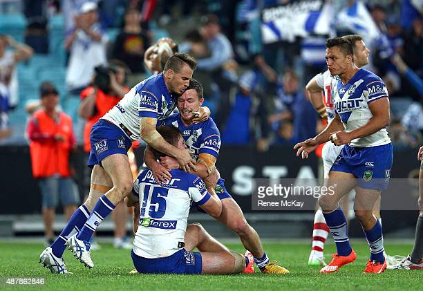 Shaun Lane of the Bulldogs celebrates his try with team mates Damien Cook and Josh Reynolds during the NRL Elimination Final match between the...
