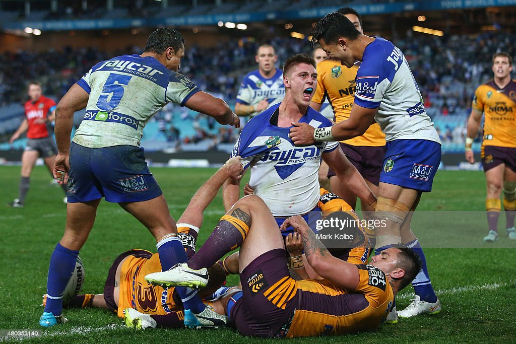Shaun Lane of the Bulldogs celebrates scoring a try during the round 18 NRL match between the Canterbury Bulldogs and the Brisbane Broncos at ANZ...