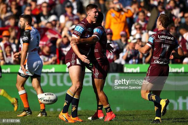 Shaun Lane of the Sea Eagles celebrates scoring a try during the round 19 NRL match between the Manly Sea Eagles and the Wests Tigers at Lottoland on...