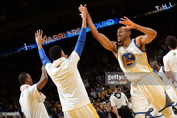 Shaun Livingston and Andre Iguodala of the Golden State Warriors high five during the game against the Utah Jazz on March 9 2016 at Oracle Arena in...