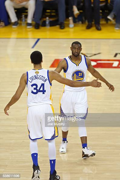 Shaun Livingston and Ian Clark of the Golden State Warriors high five during Game Two of the 2016 NBA Finals against the Cleveland Cavaliers on June...
