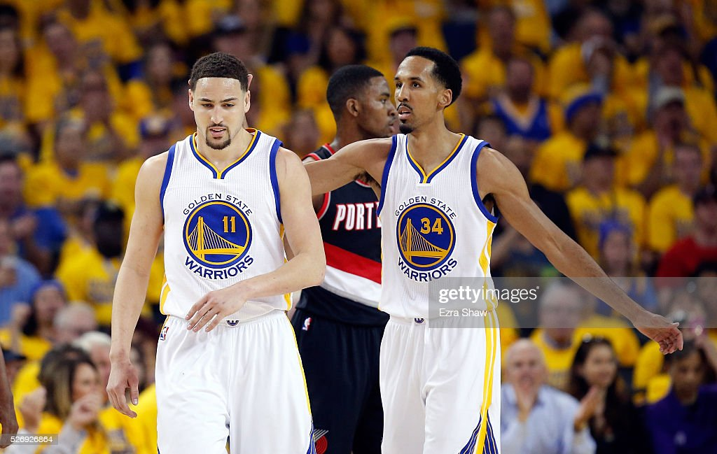 Shaun Livingston #34 congratulates Klay Thompson #11 of the Golden State Warriors during the first quarter of their game against the Portland Trail Blazers during Game One of the Western Conference Semifinals for the 2016 NBA Playoffs at ORACLE Arena on May 01, 2016 in Oakland, California.