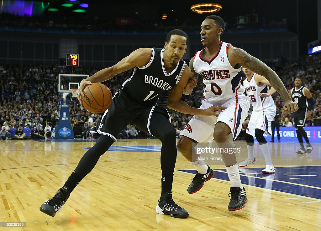 Shaun Livingston of Brooklyn Nets in action with Jeff Teague of Atlanta Hawks during the Eastern Conference NBA match between Brooklyn Nets and Atlanta Hawks at O2 Arena on January 16, 2014 in London, England.