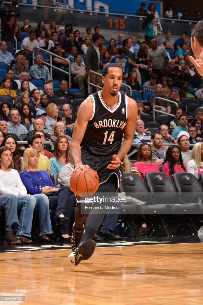 <a gi-track='captionPersonalityLinkClicked' href=/galleries/search?phrase=Shaun+Livingston&family=editorial&specificpeople=202955 ng-click='$event.stopPropagation()'>Shaun Livingston</a> #14 of the Brooklyn Nets drives against the Orlando Magic on November 3, 2013 at Amway Center in Orlando, Florida.