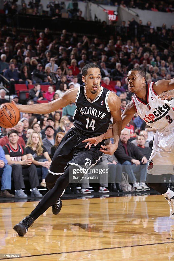 <a gi-track='captionPersonalityLinkClicked' href=/galleries/search?phrase=Shaun+Livingston&family=editorial&specificpeople=202955 ng-click='$event.stopPropagation()'>Shaun Livingston</a> #14 of the Brooklyn Nets drives to the basket against the Portland Trail Blazers on February 26, 2014 at the Moda Center Arena in Portland, Oregon.