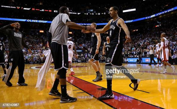 Shaun Livingston of the Brooklyn Nets reacts to winning a game against the Miami Heat at American Airlines Arena on March 12 2014 in Miami Florida...
