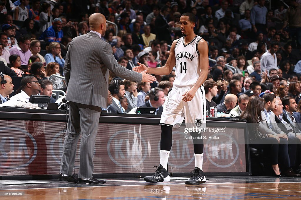 <a gi-track='captionPersonalityLinkClicked' href=/galleries/search?phrase=Shaun+Livingston&family=editorial&specificpeople=202955 ng-click='$event.stopPropagation()'>Shaun Livingston</a> #14 of the Brooklyn Nets shaking hands with <a gi-track='captionPersonalityLinkClicked' href=/galleries/search?phrase=Jason+Kidd&family=editorial&specificpeople=201560 ng-click='$event.stopPropagation()'>Jason Kidd</a> during a game against the New York Knicks during a game at Barclays Center on December 5, 2013 in the Brooklyn borough of New York City.